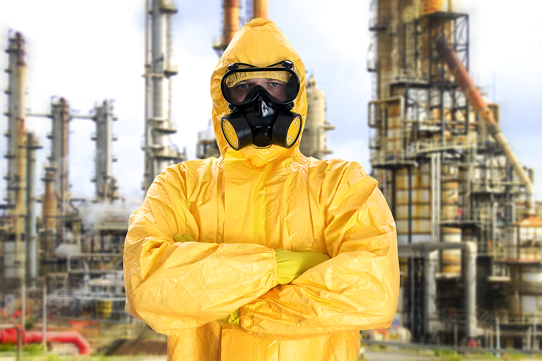 man-in-chemical-protective-suit-over-factory